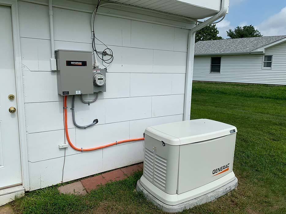 Generac generator installed near exterior electric box